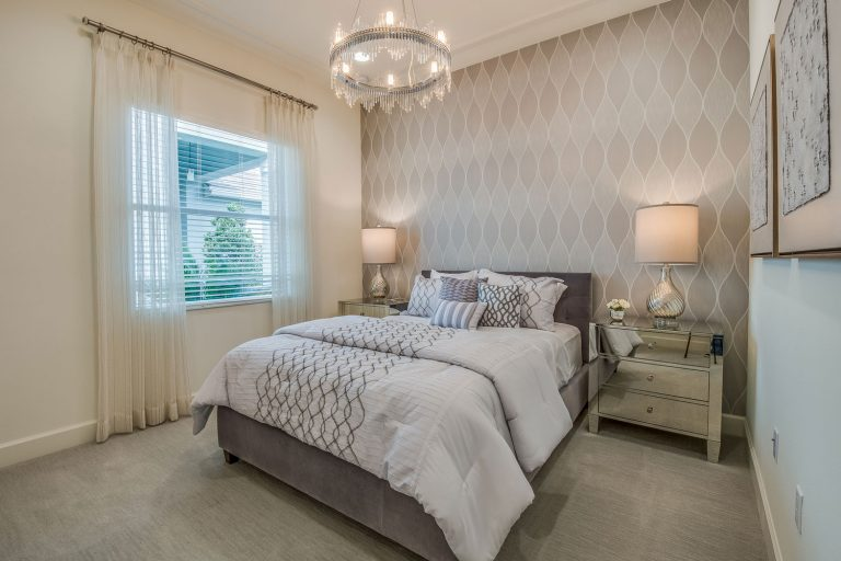 Beautiful bedroom with decorative wallpaper and sheer curtains, Does Wallpaper Last Longer Than Paint?