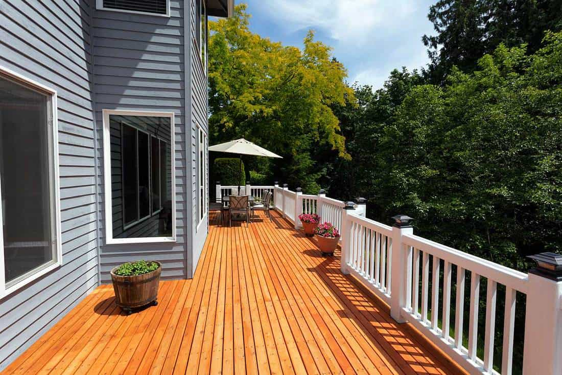 Brand new red cedar outdoor wooden patio during nice weather in horizontal layout