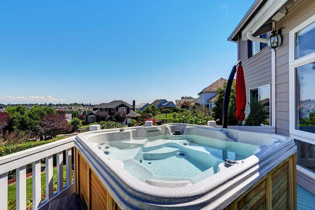 Close up of wooden hot tub on luxury house exterior