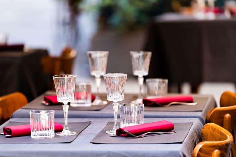 Closeup of four glasses with placemats and tablecloth, Should You Use Placemats With A Tablecloth?