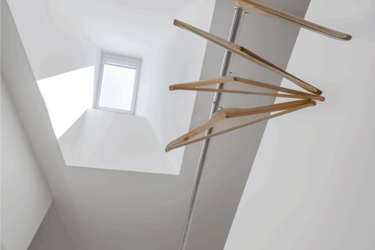 Clothes hanger under skylight. How To Make Use Of A Closet With A Sloped Ceiling