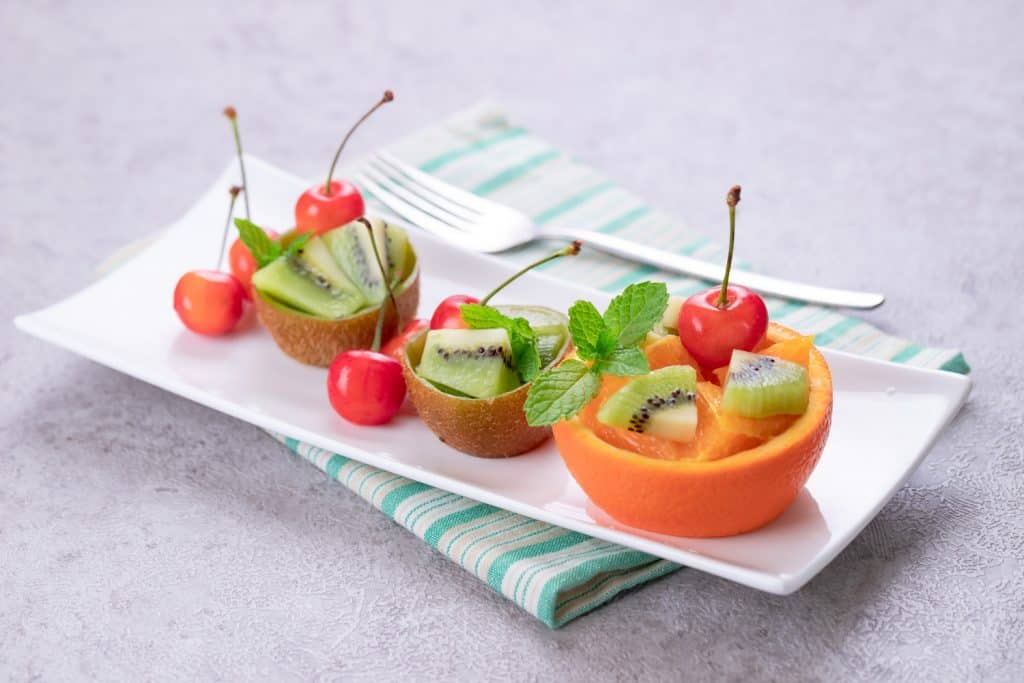 Delicious fruits in plate on a festive table