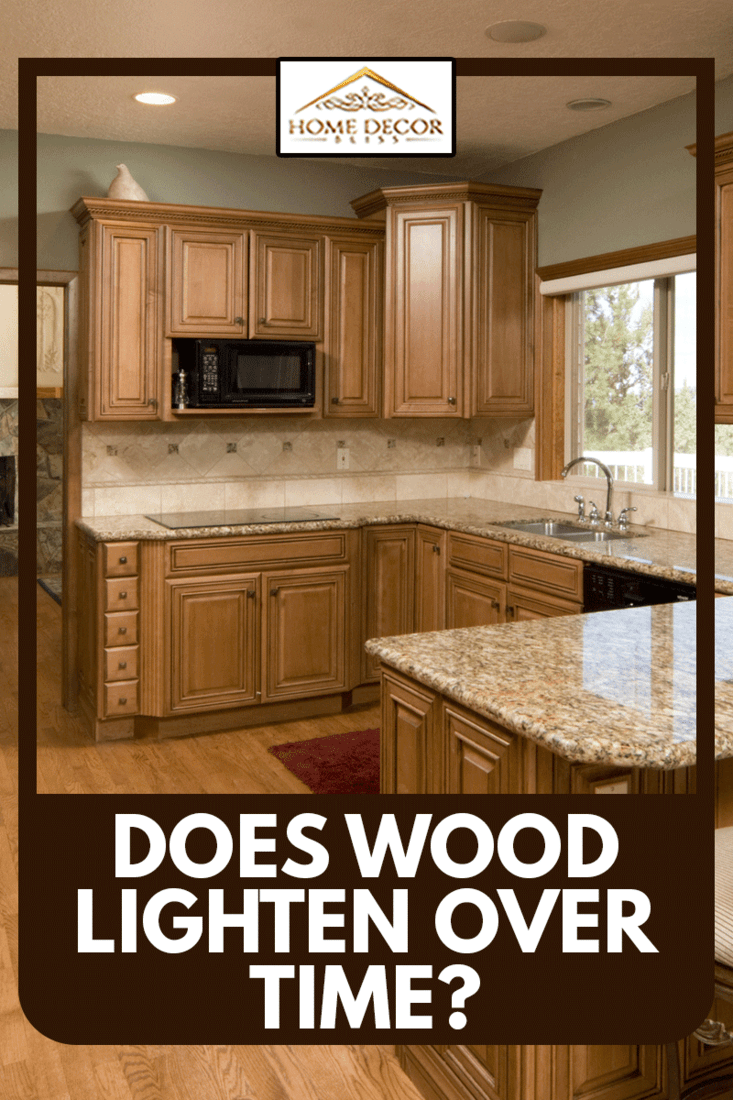 Kitchen, with alder cabinets and floor, marble counters, with carved bar stools, Does Wood Lighten Over Time?