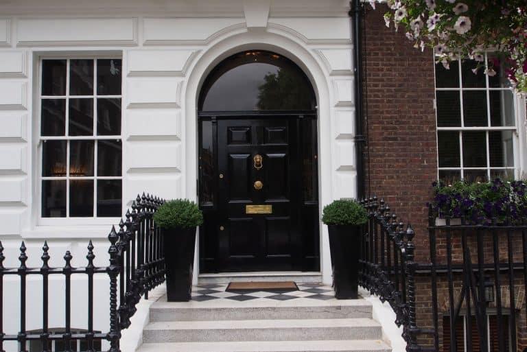 Elegant black front door with brass door knob, What Color Door Knobs With Black Doors?
