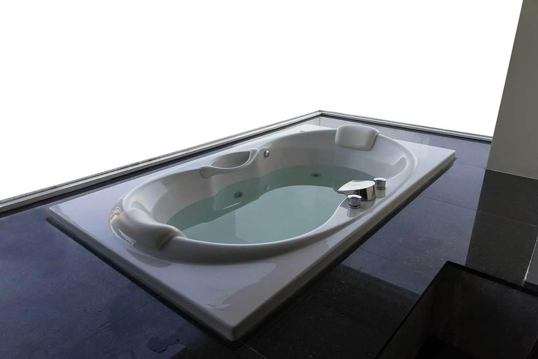 Empty white massaging jetted bathtub