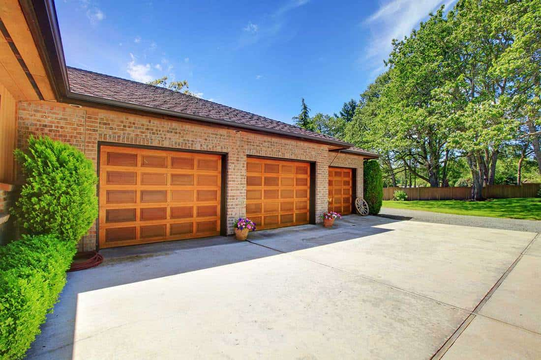 Farm house with large three car garage with nice doors