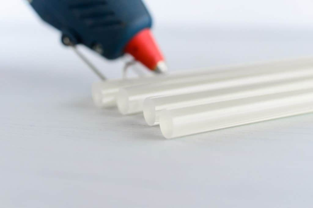 Four pieces of glue stick on a white table