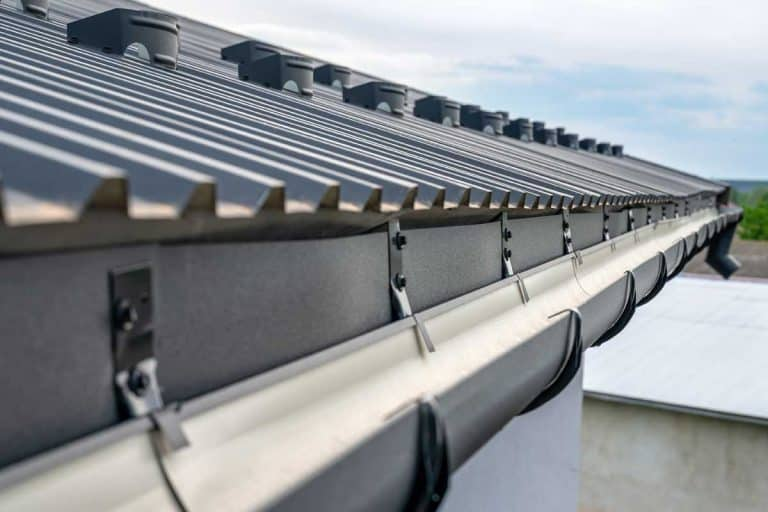 Holder gutter drainage system on the roof, What Color Gutters Go With A Black Roof?