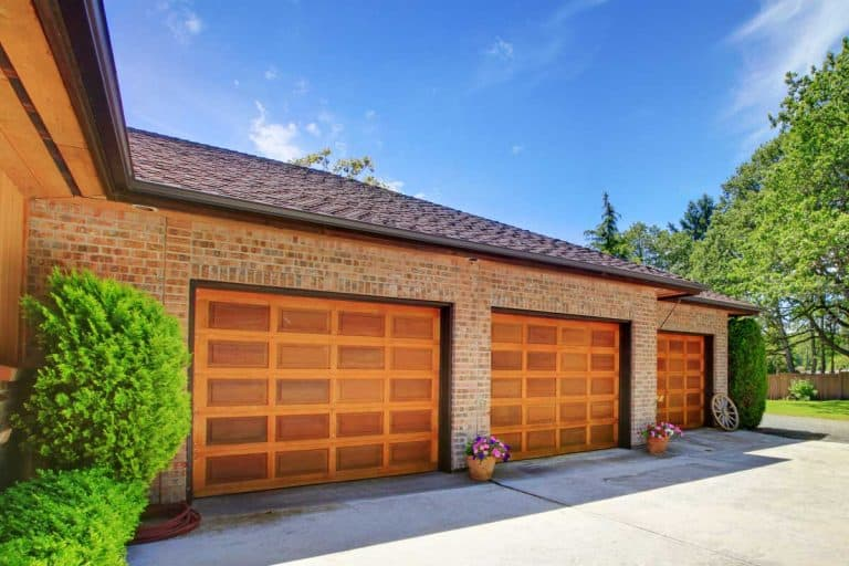 House with large three car garage with nice doors, What Color Garage Door Goes With A Tan House?
