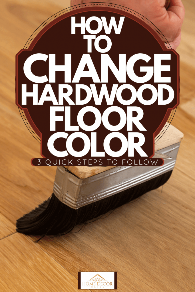 A painted using a brush to clean the wooden tiles before painting, How To Change Hardwood Floor Color [3 Quick Steps To Follow]