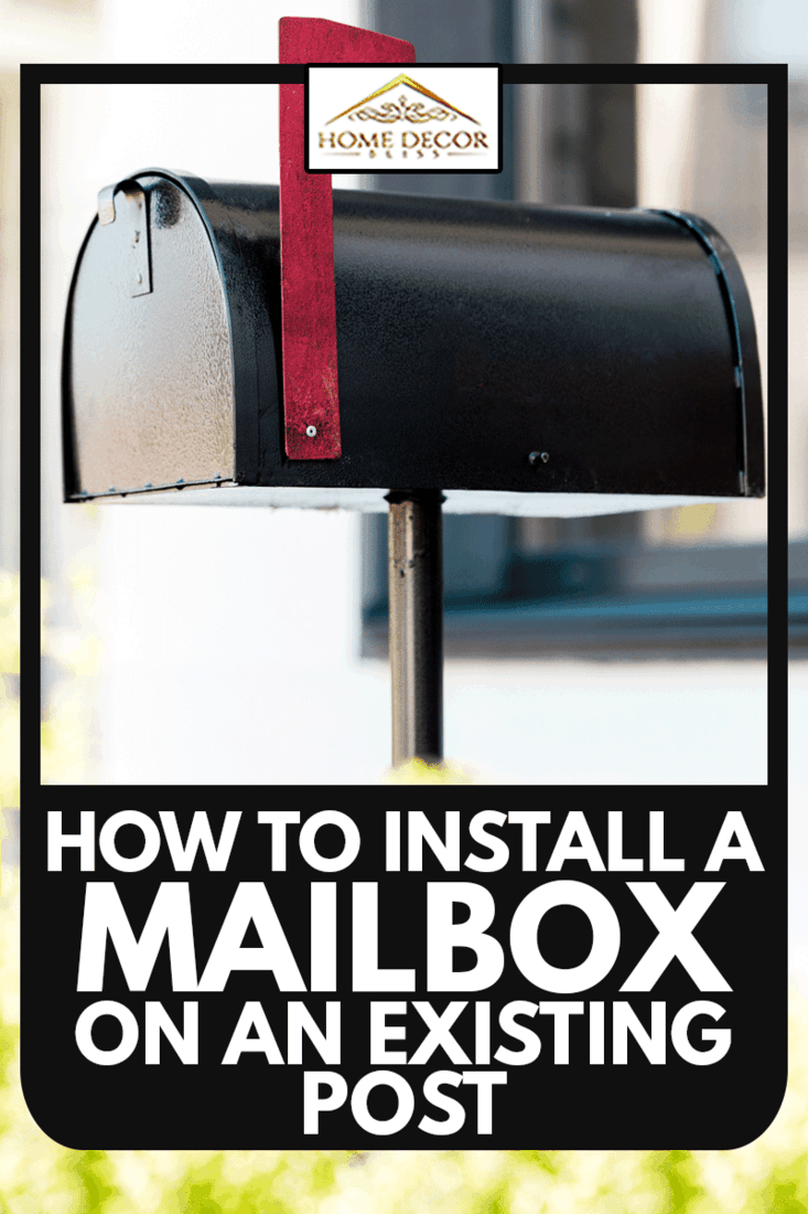 Selective focus of black metal mailbox near green bushes before house, How To Install A Mailbox On An Existing Post