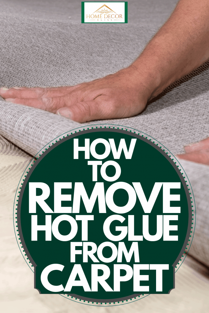 A man rolling a carpet to glue it in his living room, How To Remove Hot Glue From Carpet