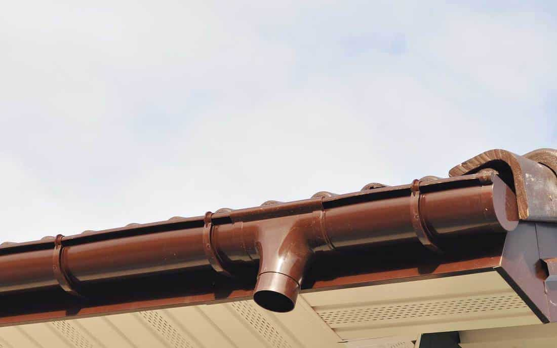 Install drainage system with plastic siding soffits and eaves exterior