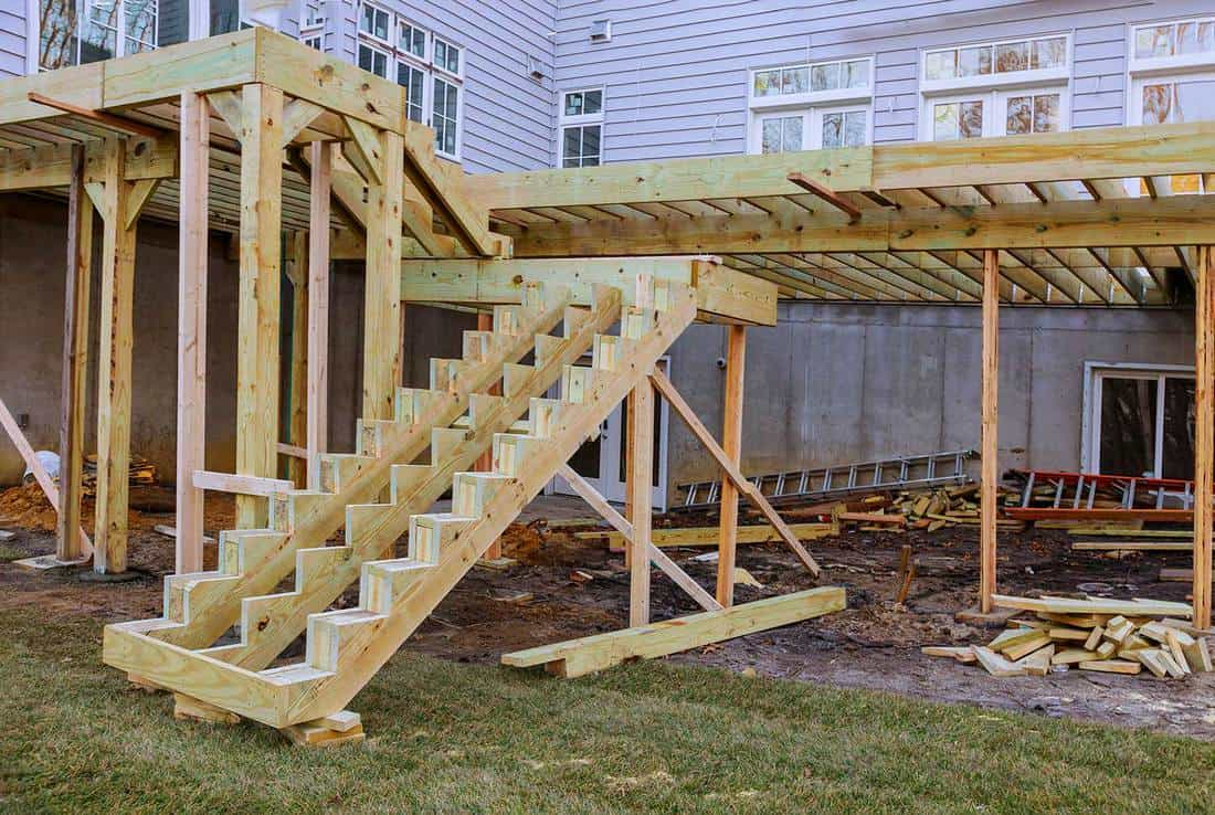 Installing deck patio construction boards with above ground deck