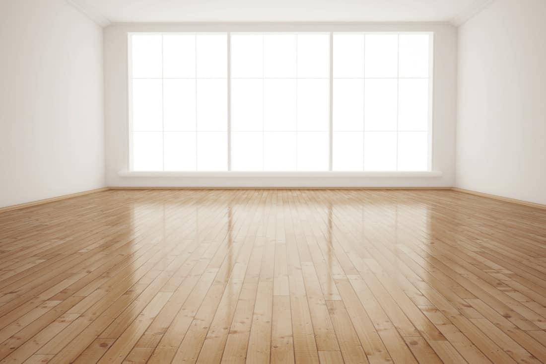 Interior empty room with polished hardwood floor
