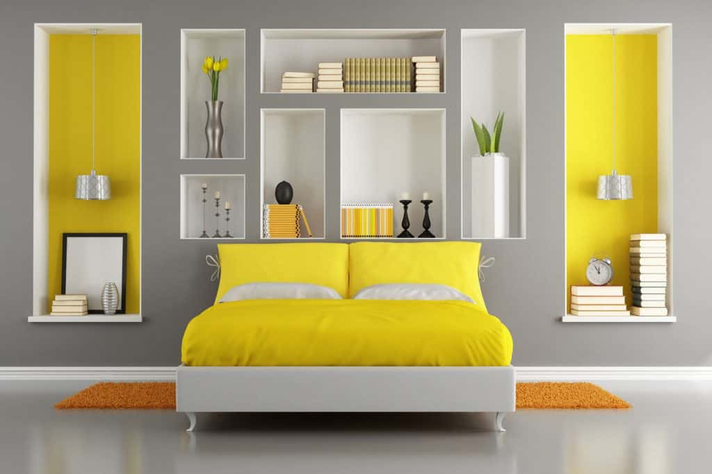 Interior of a yellow and gray themed ultra modern bathroom