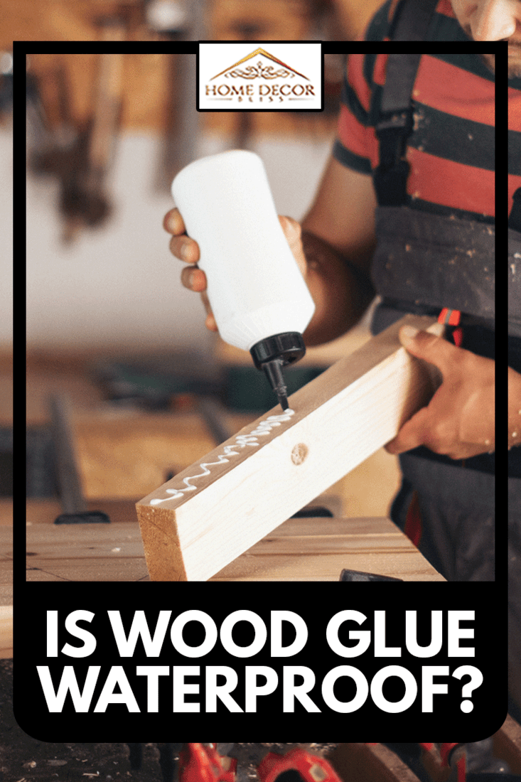 Young carpenter working with wood with wood glue, Is Wood Glue Waterproof?