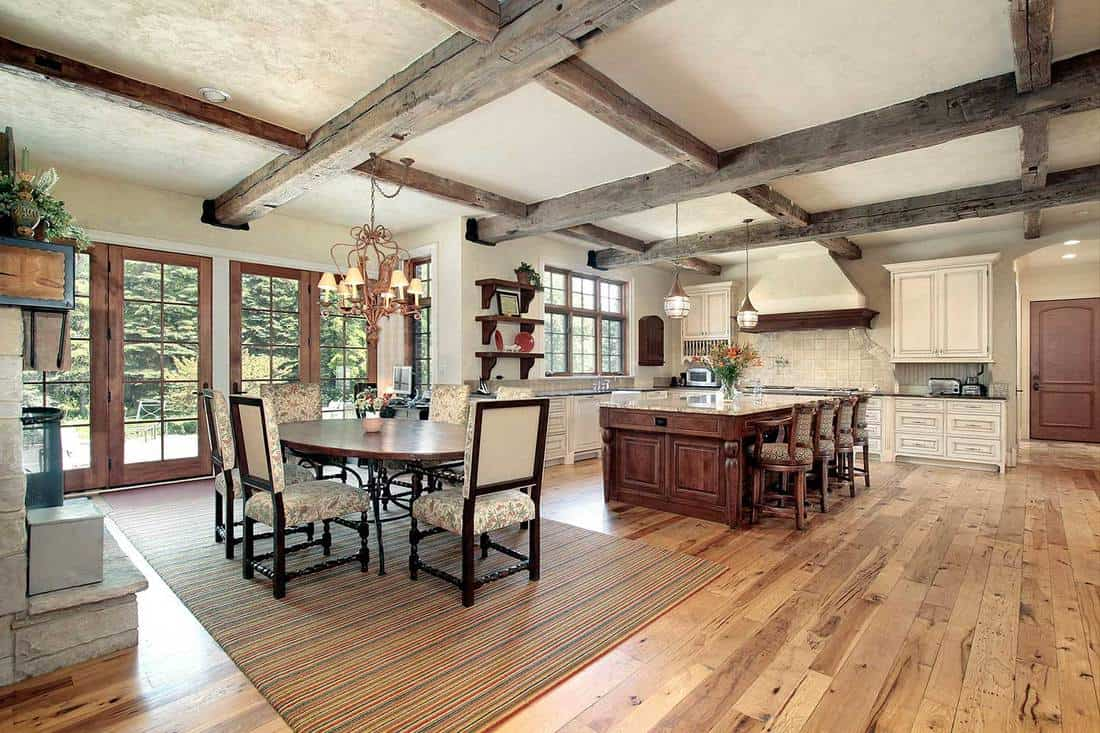 Kitchen with island and ceiling wood beams