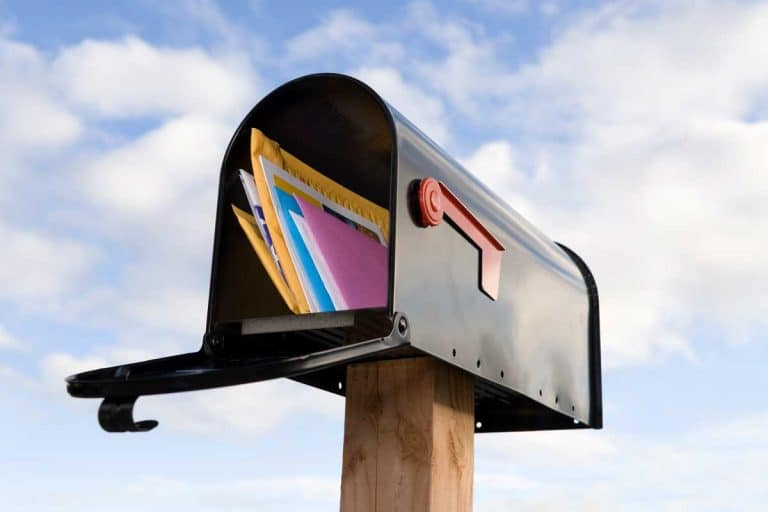 Mailbox and mail with blue sky background, How To Install A Mailbox Post [Including Without Concrete!]