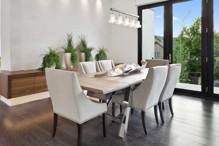 Modern home with white walls, beautiful clear glass doors and stylish furnishings in dining room, 11 Dining Room Recessed Lighting Ideas