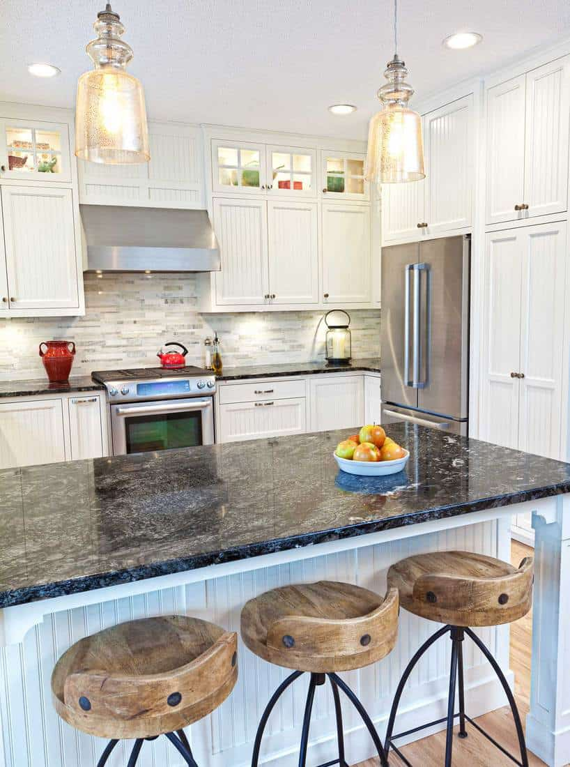 Newly updated contemporary open concept kitchen with new stainless steel appliances and granite counter top