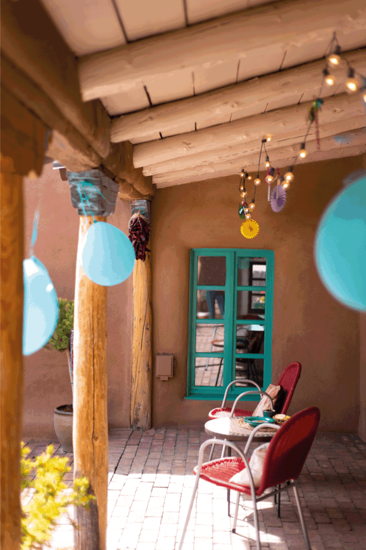 Party Decorations on Porch: String Lights and Balloons