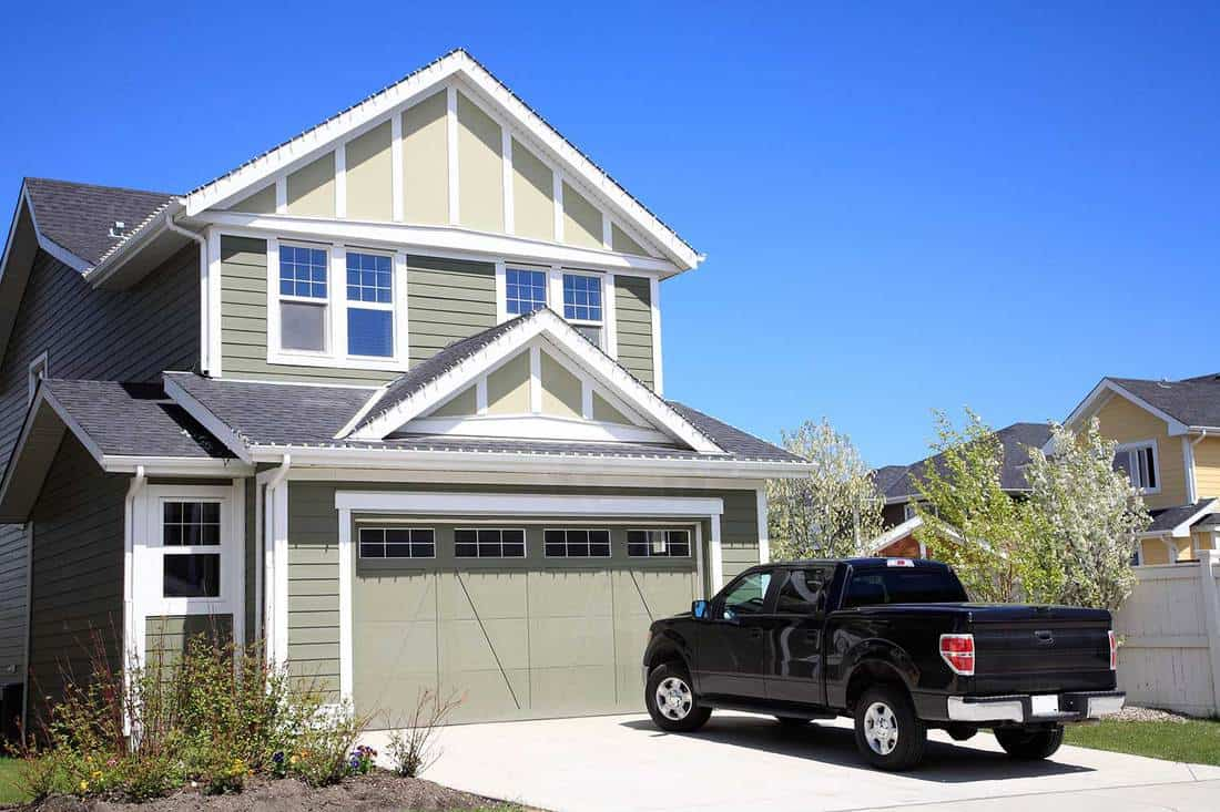 New two-storey home with 4X4 truck parked in driveway
