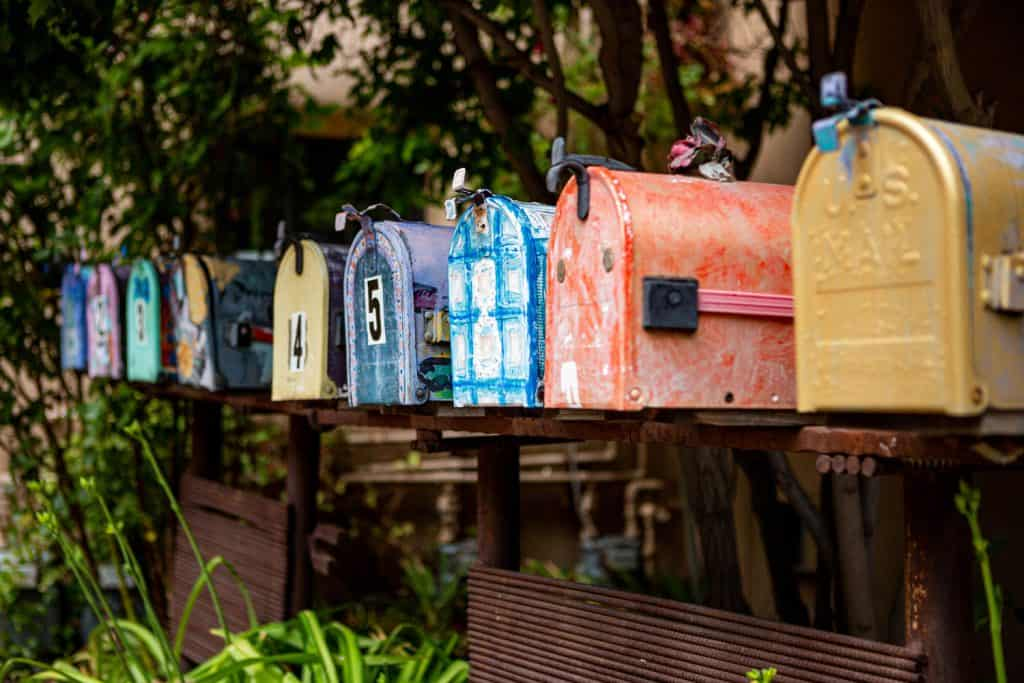 Row of painted mailboxes along Canyon Road in Santa Fe, New Mexico - southwest USA - The homes along Canyon Road have been turned into elite art galleries and shops that cater to the southwest art market.
