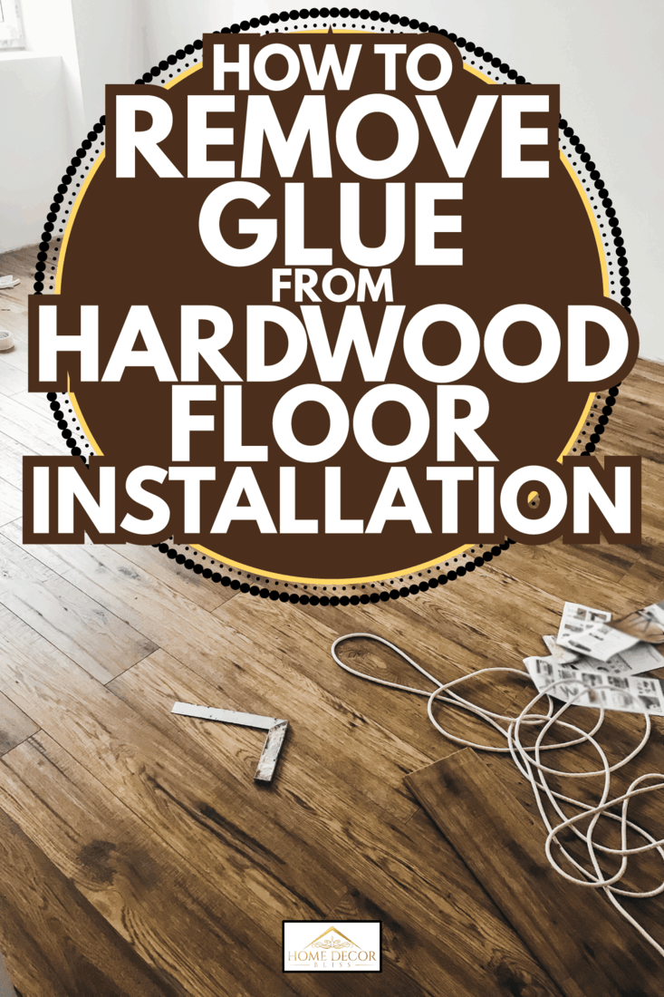 Room floor renovation concept. stylish wooden laminate installation, modern white walls. How To Remove Glue From Hardwood Floor Installation