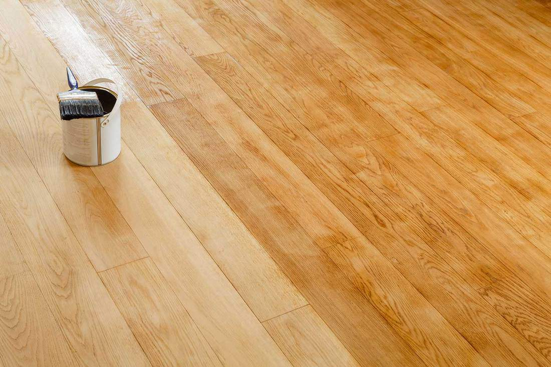 Staining wooden floor in a room
