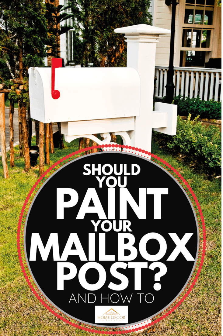 The Old postbox painted in white in fron of lawn of a home. Should You Paint Your Mailbox Post [And How To]