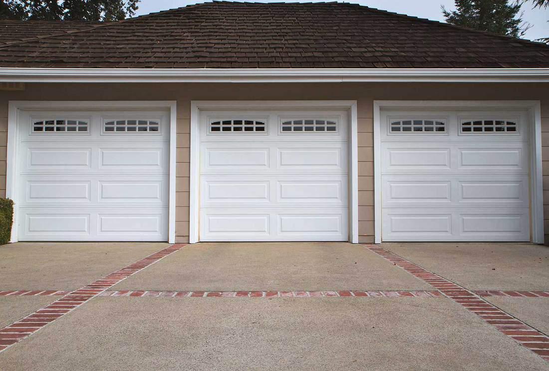 Three white car garage close