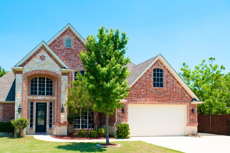 Two story brick residential home with the garage in the front, What Color Garage Door With Red Brick House