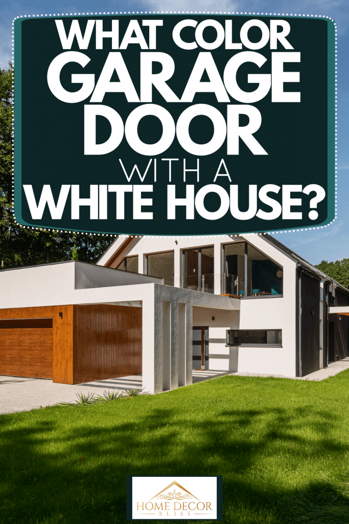 A huge and gorgeous barnhouse with wooden cladding on the garage door with a stunning landscaping, What Color Garage Door With A White House?