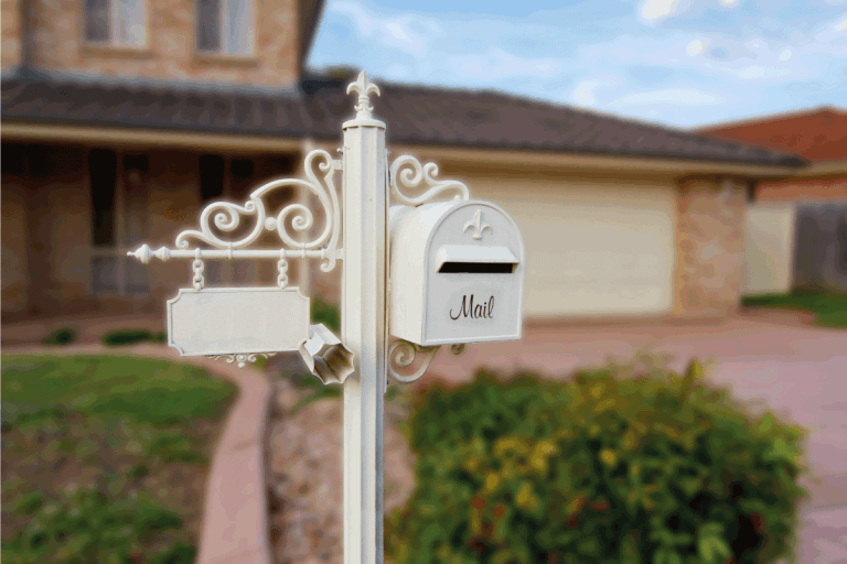 White-ornamental-Letter-box-in-front-of-a-home.-Should-You-Paint-Your-Mailbox-Post-[And-How-To]