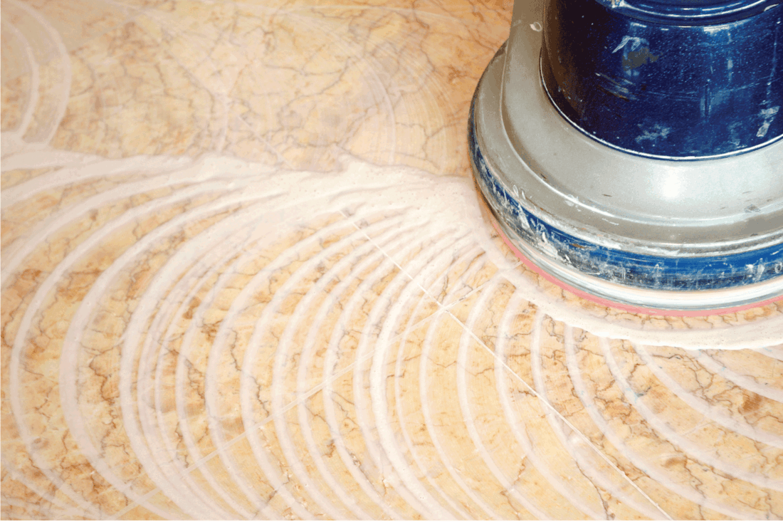 floor poliching machine with wax working on a marble floor