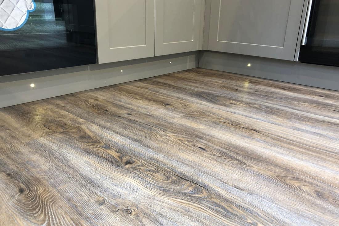 spot halogen lights under grey kitchen cabinets