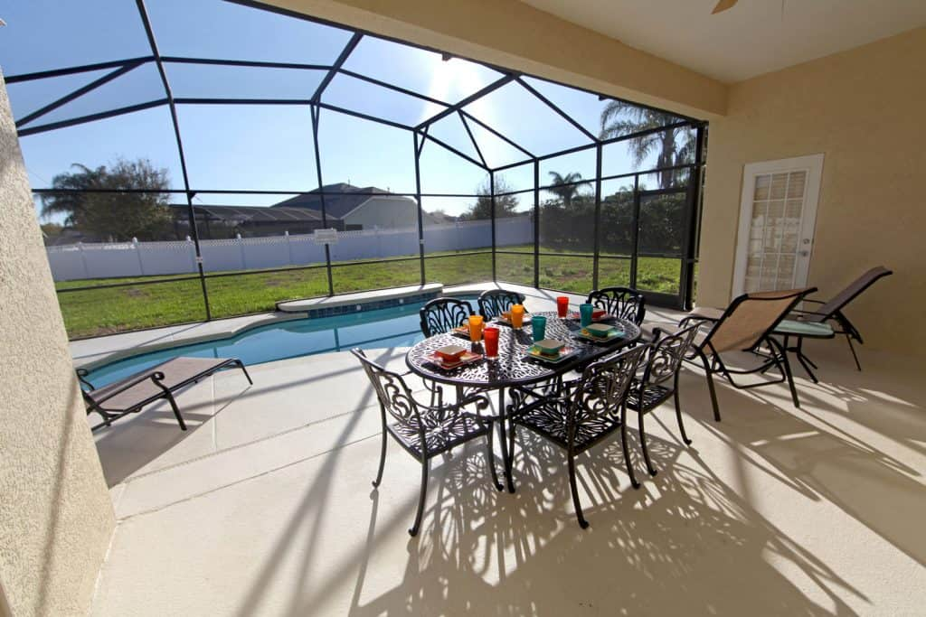 A huge lanai screen area with a pool and an entertainment
