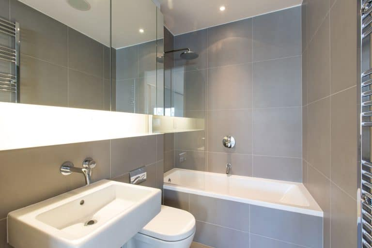 A narrow bathroom with gray colored walls and a jacuzzi tub with a shower, How To Add A Shower To A Jacuzzi Tub