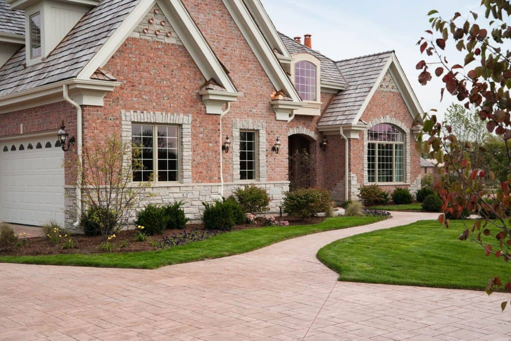 A red brick mansion with gorgeous landscaping and newly lawn landscaping