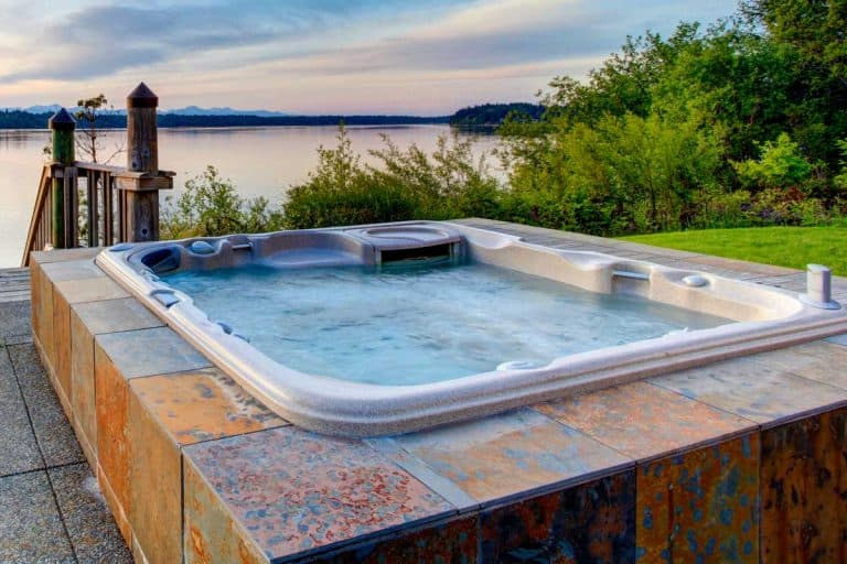 Awesome water view with hot tub at dusk, 21 Amazing Outdoor Jacuzzi And Hot Tub Ideas