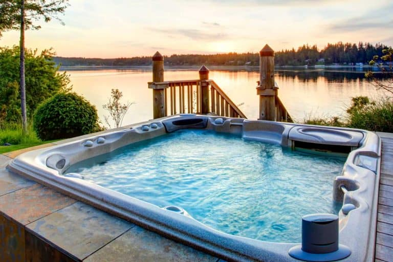 Awesome water view with hot tub in summer evening, How Big Is A Jacuzzi Tub?