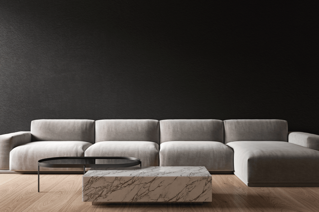 Black minimalistic interior with marble coffee table and sofa