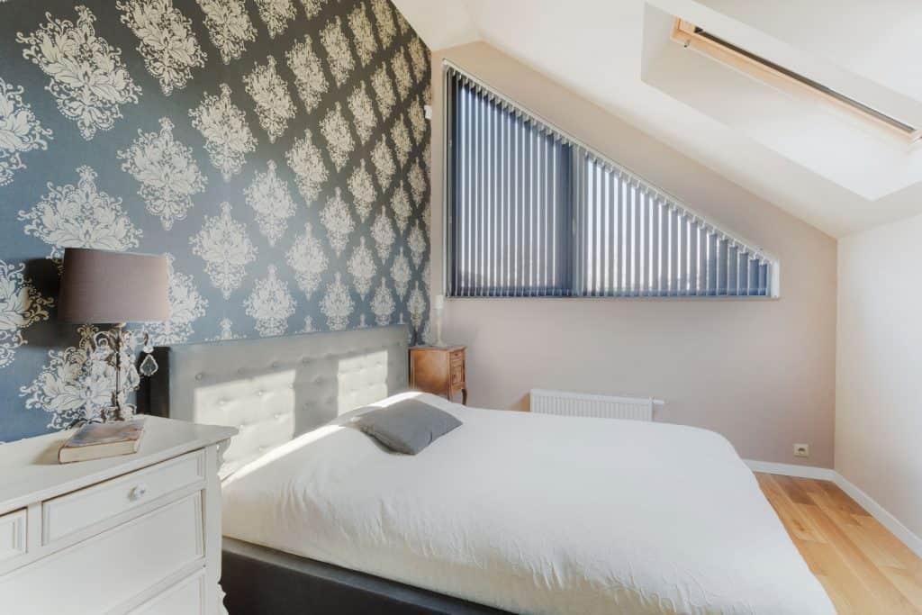 Black oriental wallpaper in small bright bedroom