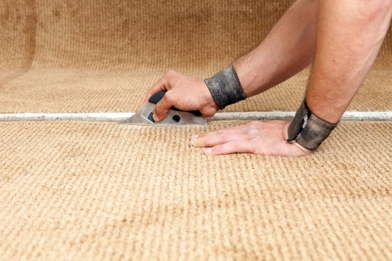 Carpet installer using cushion back cutter, How To Use A Cushion Back Carpet Cutter