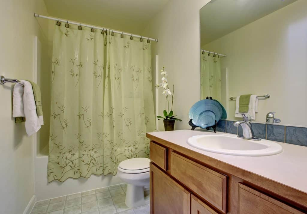 Classic bathroom with green shower curtain