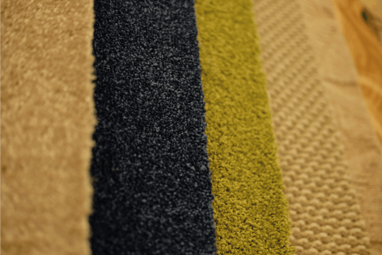 Colorful carpet samples on exhibition for retail. How Long Can You Leave Carpet Protector On