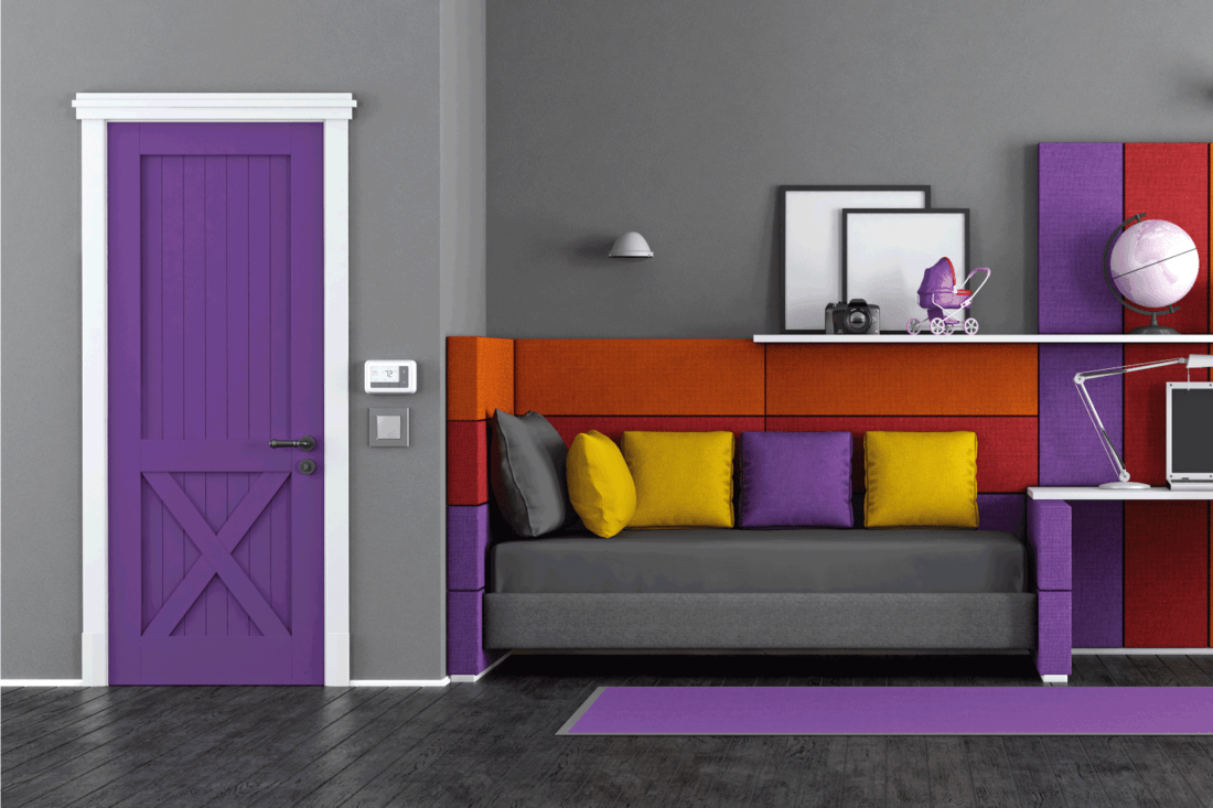 Colorful teen bedroom with fabric bed, desk and closed door
