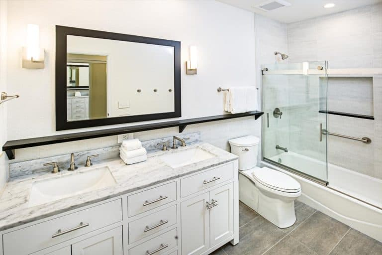 Contemporary bathroom design with vanity and shower bathtub, What Color Mirror Goes With A White Vanity?