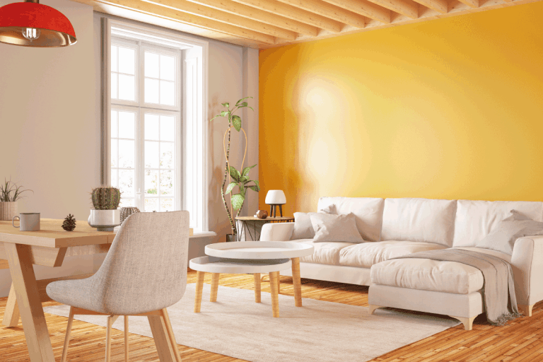 Cozy Yellow Living Room with Table and Sofa. What Wallpaper Goes With Yellow Walls